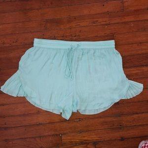 aqua blue shorts with ruffles